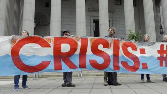 on the first day of a civil lawsuit climate activist from 350org and from rise and resist stand outside of the new york supreme court during a civil... - exxon stock videos & royalty-free footage