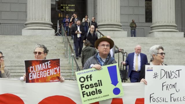 on the first day of a civil lawsuit climate activist from 350org and from rise and resist stand outside of the new york supreme court during a civil... - climate finance stock videos & royalty-free footage