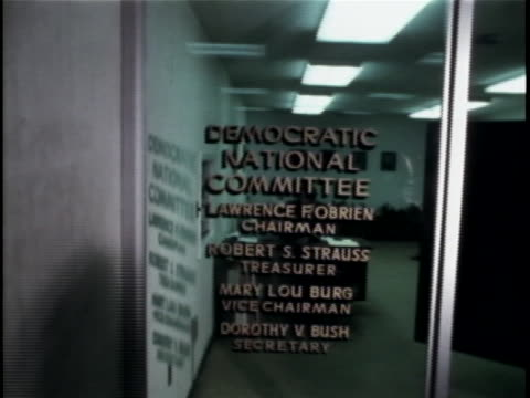 on the glass wall it has all of the democratic national committee officers in the watergate complex. the watergate incident is a political scandal... - resignation of richard nixon stock videos & royalty-free footage