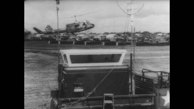 on the ground at tan son nhut air base in south vietnam / members of the 120th aviation company 'the doens' inside radio base one with binoculars one... - pilot bildbanksvideor och videomaterial från bakom kulisserna