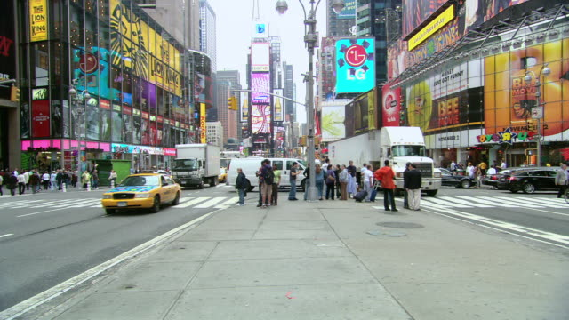pov on the median in times square looking toward the jumbotron, with traffic and pedestrians / new york city, new york, united states - median nerve stock videos & royalty-free footage