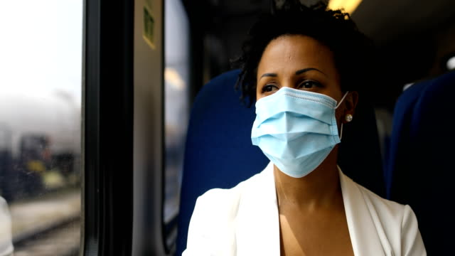on the move with flu mask - passenger train stock videos & royalty-free footage