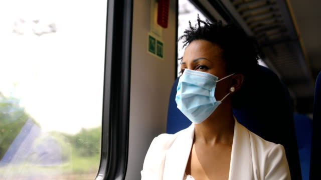 on the move with flu mask - sitting stock videos & royalty-free footage