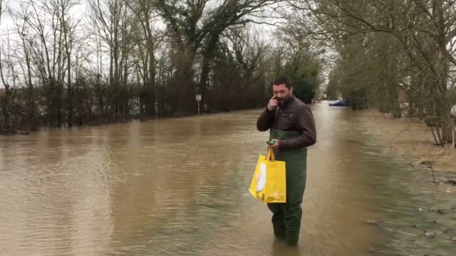 on the outskirts of upton upon severn, on a flooded road into the worcestershire town, one man was unperturbed by the conditions - heading down the... - serene people stock videos & royalty-free footage