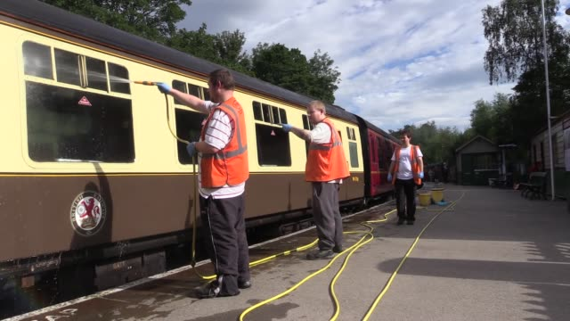 On the Pickering to Whitby line in England Also shots of mechanics repairing buffers and cleaning carriage windows
