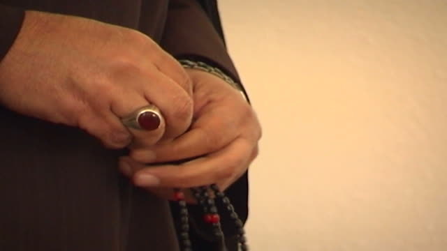 on the prayer beads in the hands of shia cleric sheikh akeel zeineddine, who is giving a sermon on the occasion of the prophet muhammad's birthday in... - worry beads stock videos & royalty-free footage