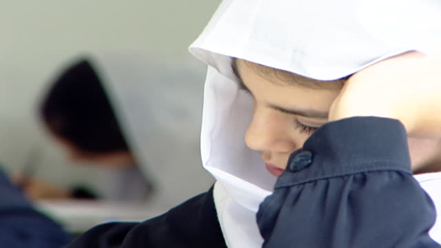 on the profile of a schoolgirl wearing a white veil known as a mandil, traditional druze attire, at irfan, a druze religious school in the chouf... - theology stock videos & royalty-free footage