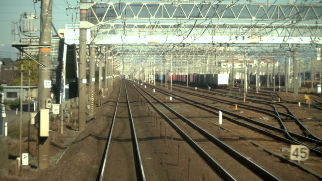 stockvideo's en b-roll-footage met op de leuning en kijken voor de lokale kyoto-trein - passenger train