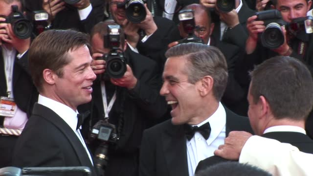 on the red carpet at the cannes film festival for the film oceans 13 brad pitt george clooney matt damon at cannes film festival on october 01 2012... - george clooney stock videos and b-roll footage