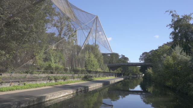 On the Regent's Canal in central London passing the Snowdon Aviary at London Zoo, in spring, With Sound