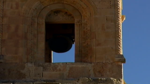 on the ringing chapel bell calling the monks to prayer at the syriac-orthodox mor hananyo monastery in the syriac cultural region known as tur abdin. - praying stock videos & royalty-free footage
