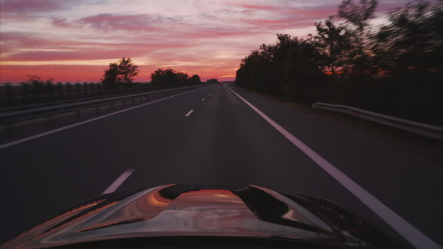 On the road at sunset.