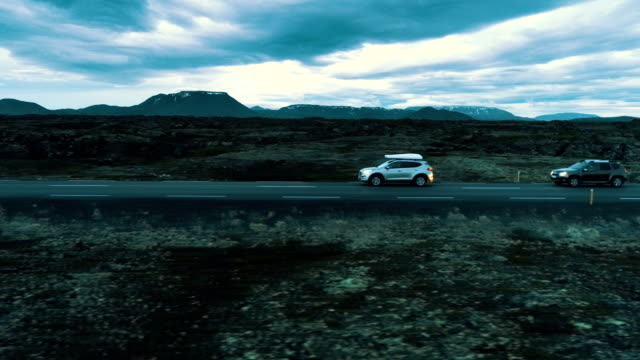 on the road. icelandic trip - hill stock videos & royalty-free footage