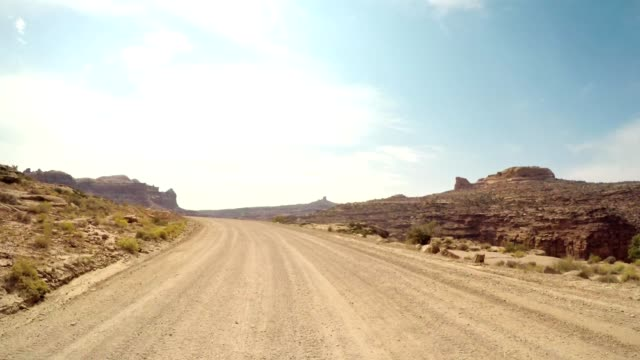 on the road in the moab national park - wild west stock videos & royalty-free footage