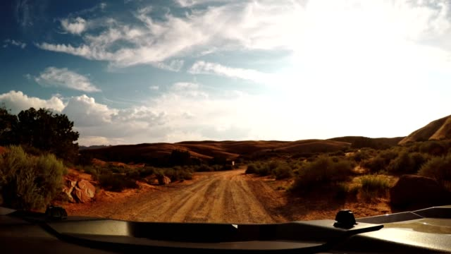 on the road in the moab national park - quadbike stock videos & royalty-free footage