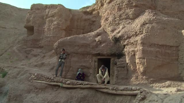 On the same sandstone cliffs that once sheltered the giant Buddhas blown up by the Taliban in 2001 hundreds of man made caves have become makeshift...