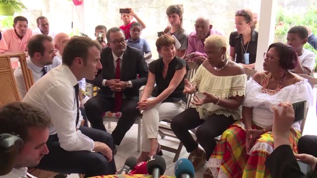 vídeos y material grabado en eventos de stock de on the second day of his tour in the antilles french president emmanuel macron discusses the problems of water supply faced by the residents of... - territorios franceses de ultramar