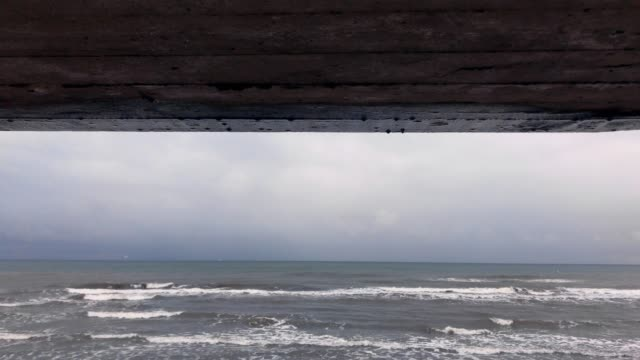 on the shore of the caspian sea - concrete wall stock videos & royalty-free footage