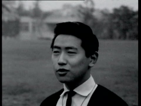 vídeos y material grabado en eventos de stock de on the street interviews young japanese women and men about american influences japanese people give opinions on western influence on october 16,... - 1964