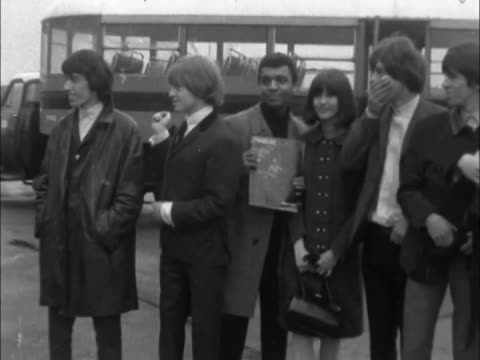 vídeos de stock e filmes b-roll de on their way to montreax and a festival of light entertainment / pan kenny lynch from bus rolling stones group of 'ready steady go' staff on with... - 1964