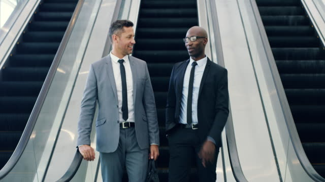 on their way to the seminar in the convention centre - nuovo video stock e b–roll