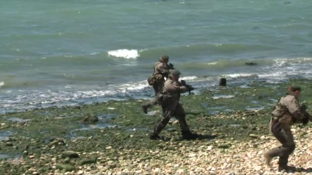 on thursday the british city of portsmouth hosted a reenactment ceremony of the biggest amphibious assault one of many events of this type planned to... - battle reenactment stock videos & royalty-free footage