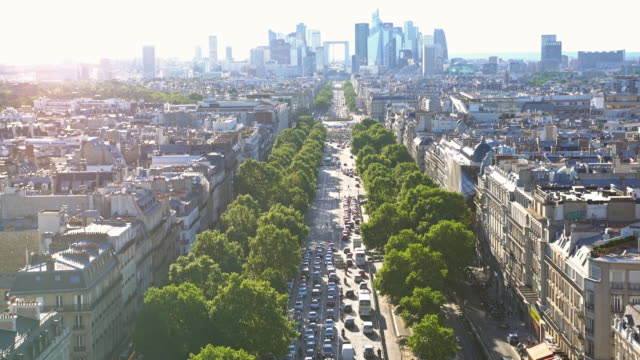 On top of Arc de Triomphe, looking down at busy avenue towards La Defense