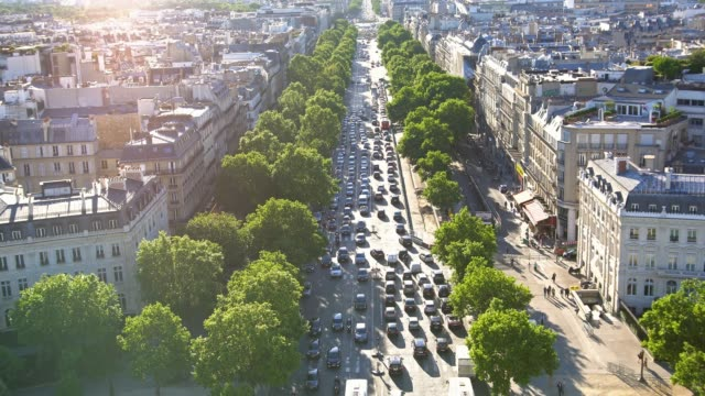 On top of Arc de Triomphe, looking down at busy avenue