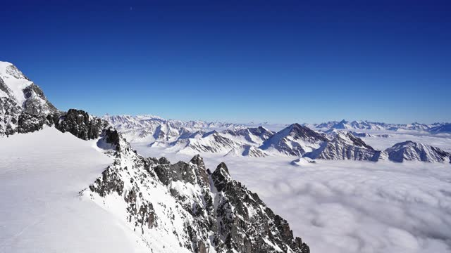 on top of mont blanc over the clouds - clear sky stock videos & royalty-free footage