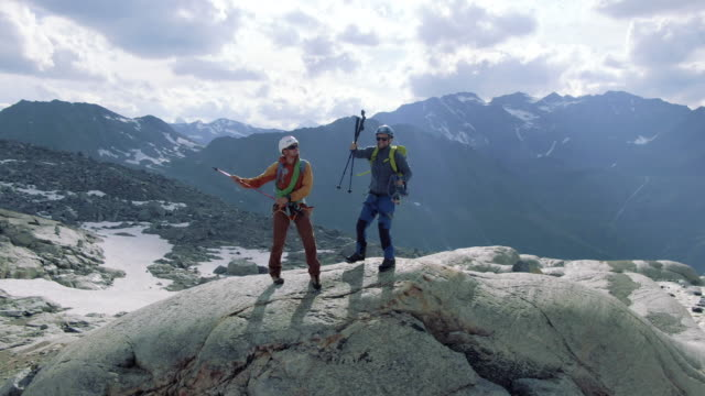 on top of the world. mont blanc climbers on a mountain top - joy stock videos & royalty-free footage