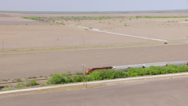 ms aerial ts on train rolling through south texas plains and route from san antonio to kingsville / texas, united states - prärie stock-videos und b-roll-filmmaterial