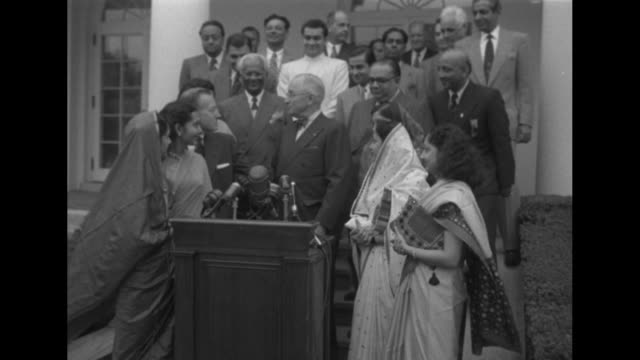 vs young women dressed in saris / men in delegation pose / men and women on steps make way for president truman to step down to podium / vs truman... - mahatma gandhi stock videos & royalty-free footage