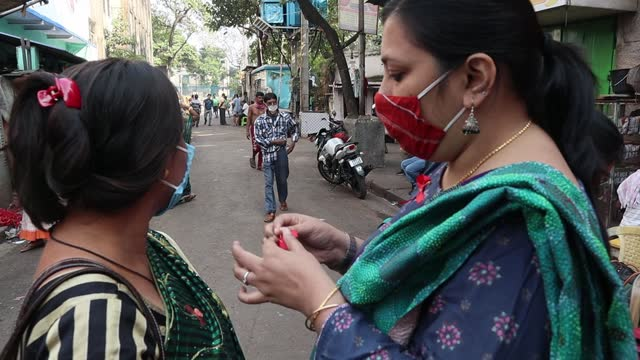 on worlds aids day sex workers have gathered at asia's one of the largest red light area sonagachi in kolkata for an awareness campaign among the sex... - aids awareness ribbon stock videos & royalty-free footage
