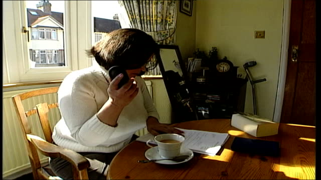 Woman urgently needing eye specialist treatment ENGLAND Karen Caplan on telephone trying to make an apointment with eye specialist Karen Caplan...