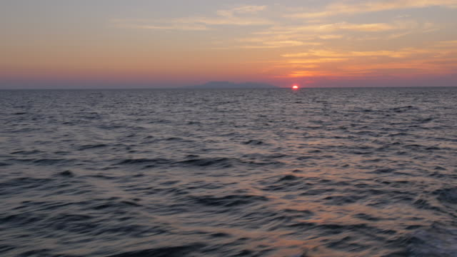 onboard boat from hvar to korcula at sunset, adriatic sea, dalmatia, croatia, europe - adriatic sea stock videos & royalty-free footage