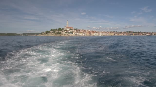 onboard boat shot of cathedral of st. euphemia and the old town on sunny day, rovinj, istria county, croatia, europe - boat point of view stock videos & royalty-free footage