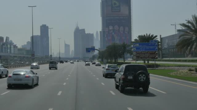 Onboard coach along Sheikh Maktoum Bin Rashid Road approaching Abu Dhab, United Arab Emirates, Middle East, Asia
