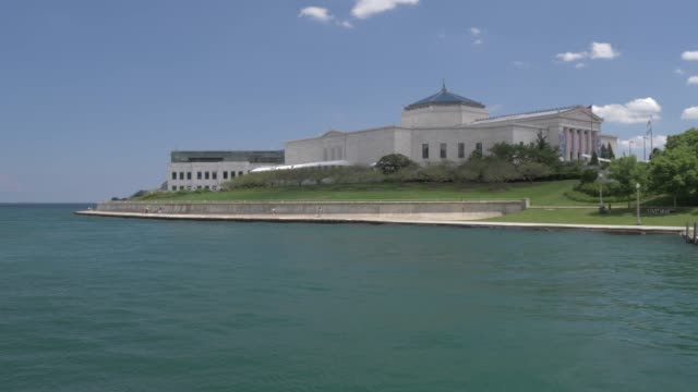 onboard cruise boat shot of shedd aquarium from lake michigan, chicago, illinois, united states of america, north america - shedd aquarium stock videos & royalty-free footage