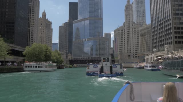 onboard cruise boat shot tracking another cruise boat and buildings lining the chicago river, chicago, illinois, united states of america, north america - chicago river stock videos & royalty-free footage