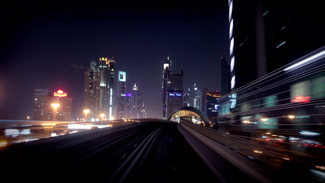 onboard the dubai metro during night - bay of water stock videos & royalty-free footage
