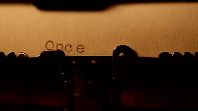 'once upon a time ' typed using an old typewriter - storytelling stock videos and b-roll footage