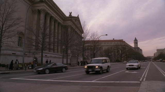 pan oncoming traffic and national archives / washington, d.c., united states - national archives washington dc stock videos & royalty-free footage