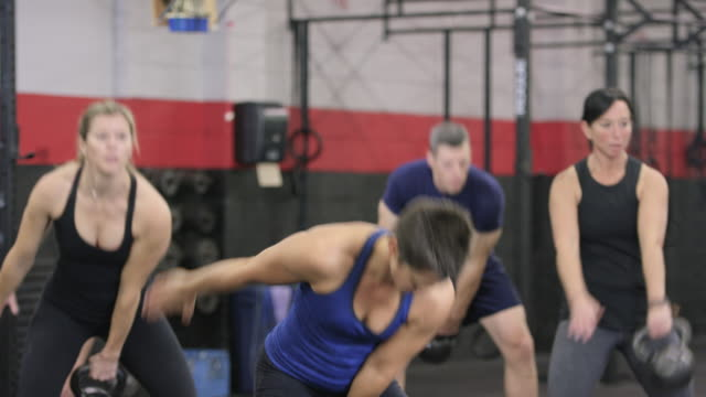 one armed kettlebell swing - fatcamera stock videos and b-roll footage