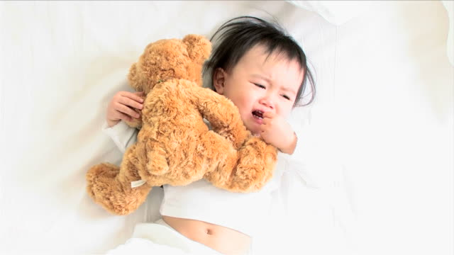 one baby is crying on the bed - one baby girl only stock videos & royalty-free footage
