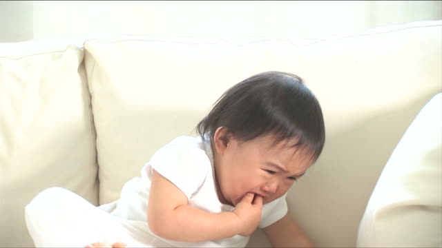 one baby is crying on the sofa - japanese ethnicity stock videos & royalty-free footage