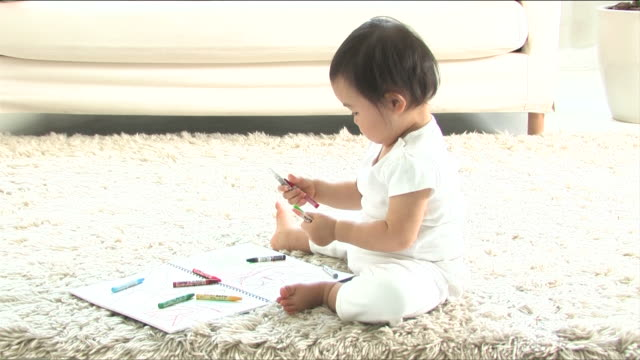one baby is drawing with crayon - crayon stock videos & royalty-free footage