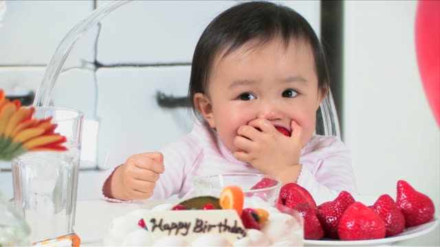 one baby is eating a strawberry and enjoying party - one baby girl only stock videos & royalty-free footage