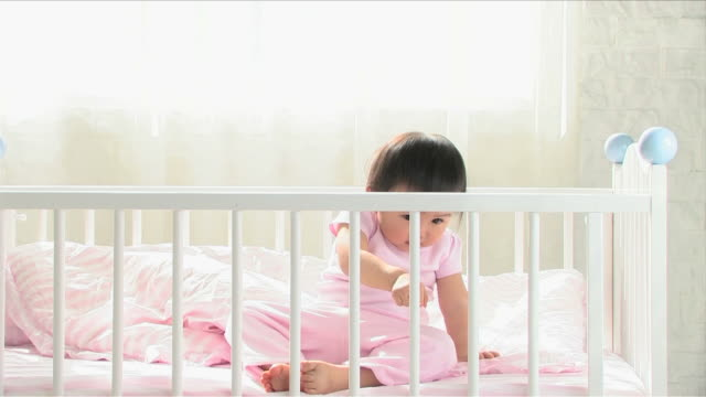 one baby is on the baby bed - one baby girl only stock videos & royalty-free footage