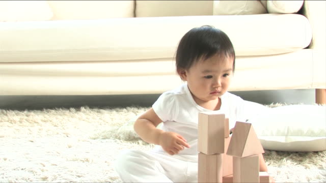 one baby is playing with blocks - one baby girl only stock videos & royalty-free footage