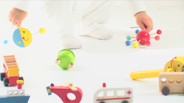 one baby is playing with toys - one baby girl only stock videos & royalty-free footage